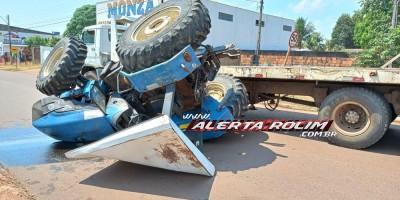 Trator caiu de caminhão prancha nesta manhã de quinta-feira em Rolim de Moura